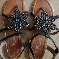 Sandalias negras de tiras y abal…